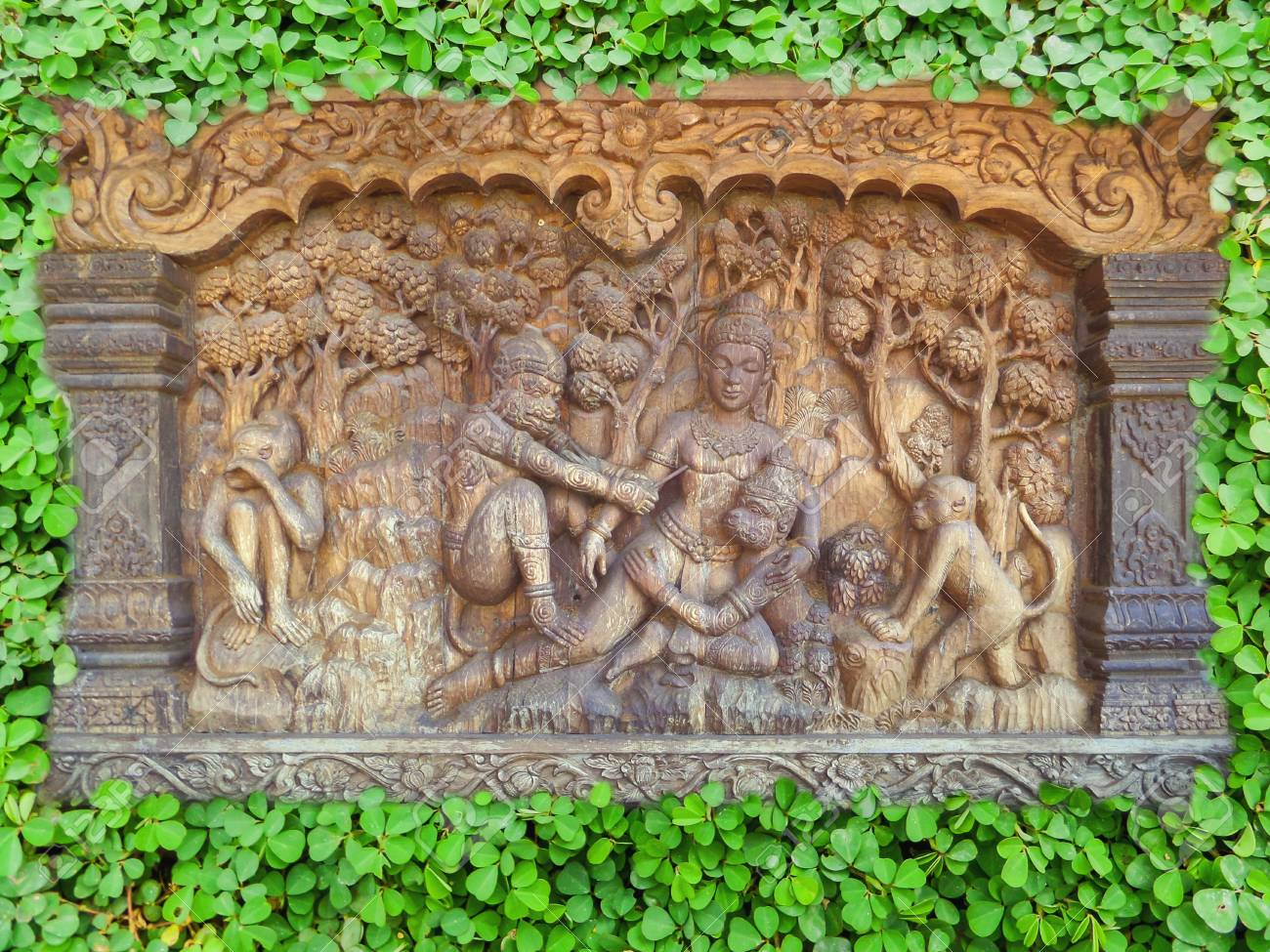 Wood Carving And Clover Background In The Garden Stock Photo ...