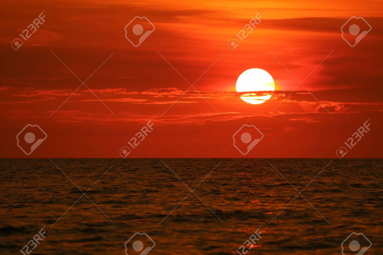 sun back on sunset sky horizon and wave on surface sea - 124526800