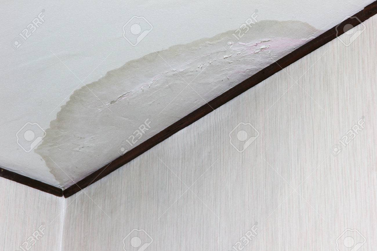 Big water stain on ceiling due to flood - 23208075