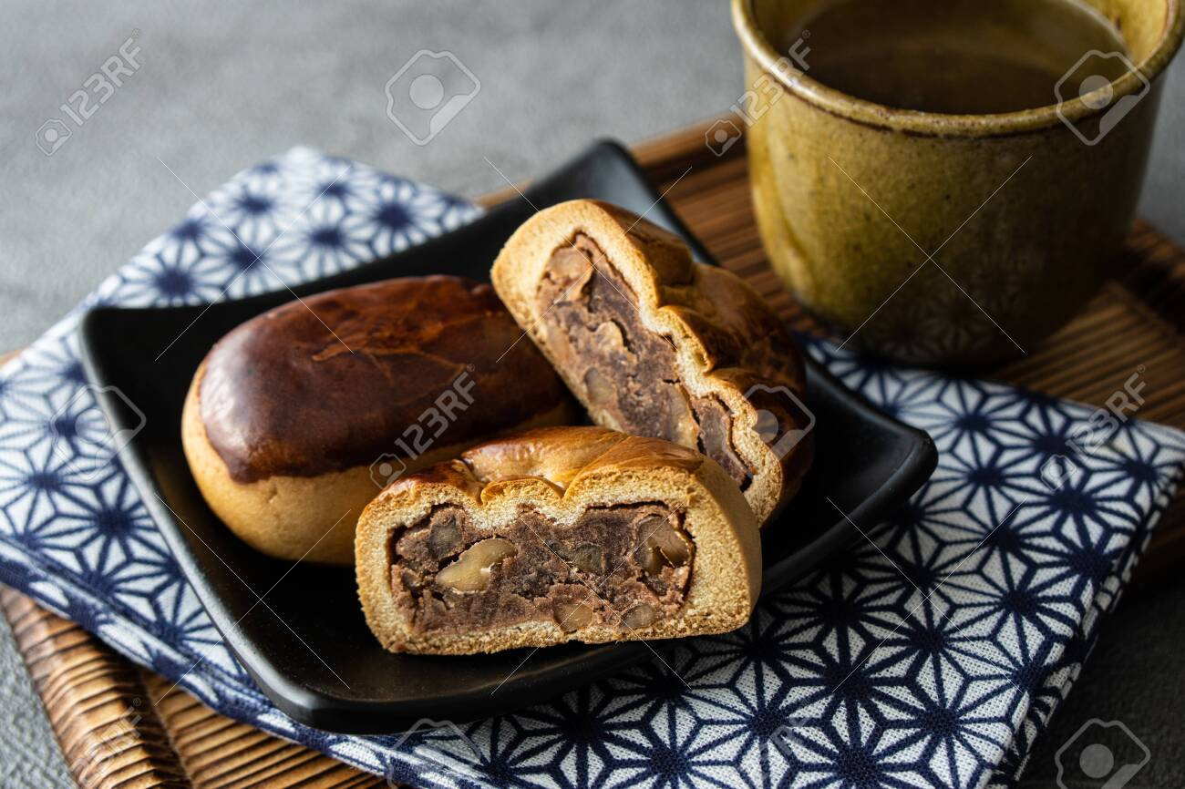 Manju, a traditional Japanese sweet snack often served with green tea. - 149442316
