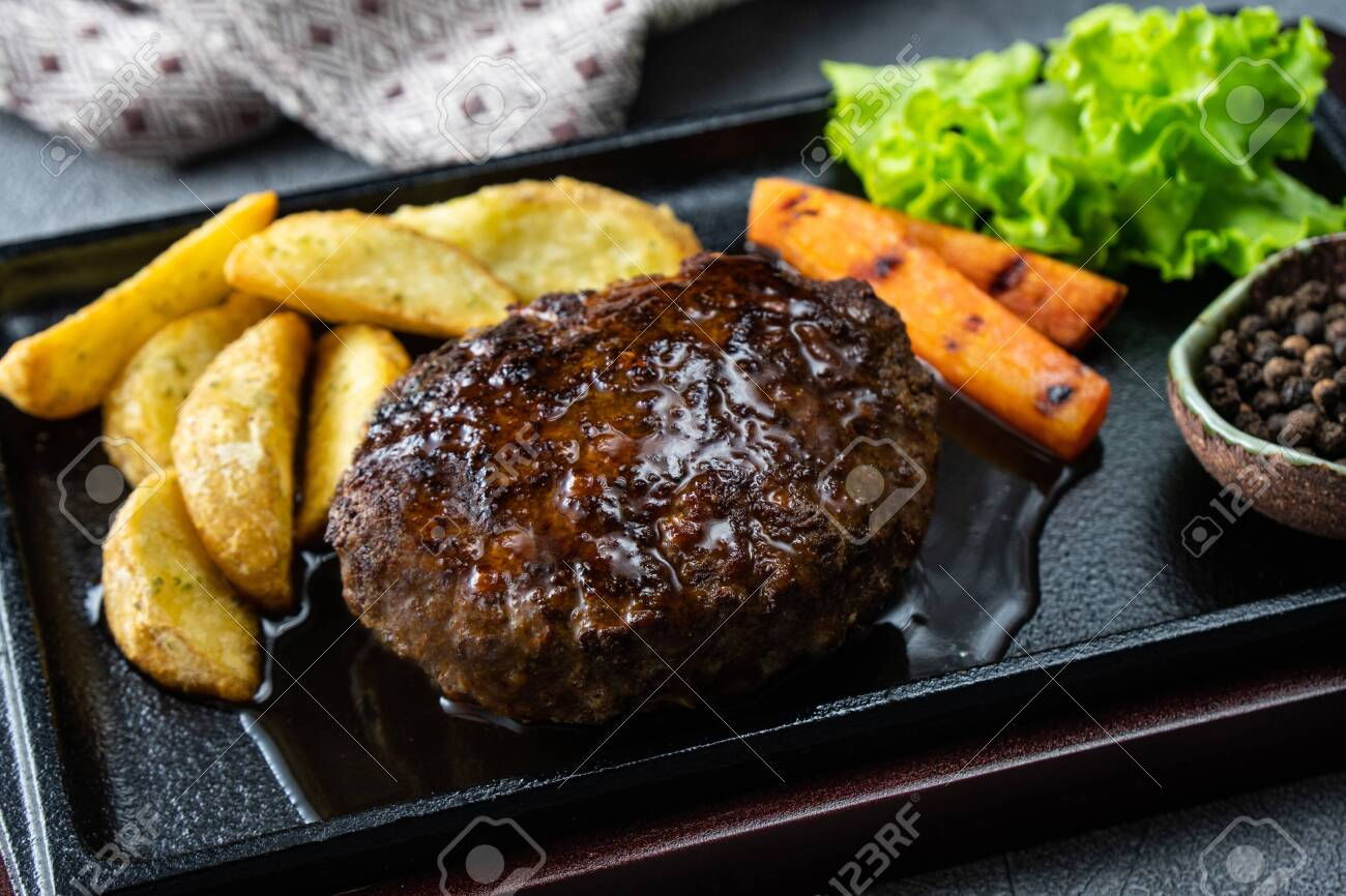 Japanese Hamburg Steak, a popular grilled meat patty served with potatoes, vegetables or rice. - 149442656