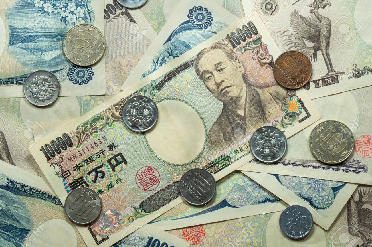 Japanese yen coins and banknotes. Yen are the official currency of Japan, a country with a wealthy economy. - 149445873