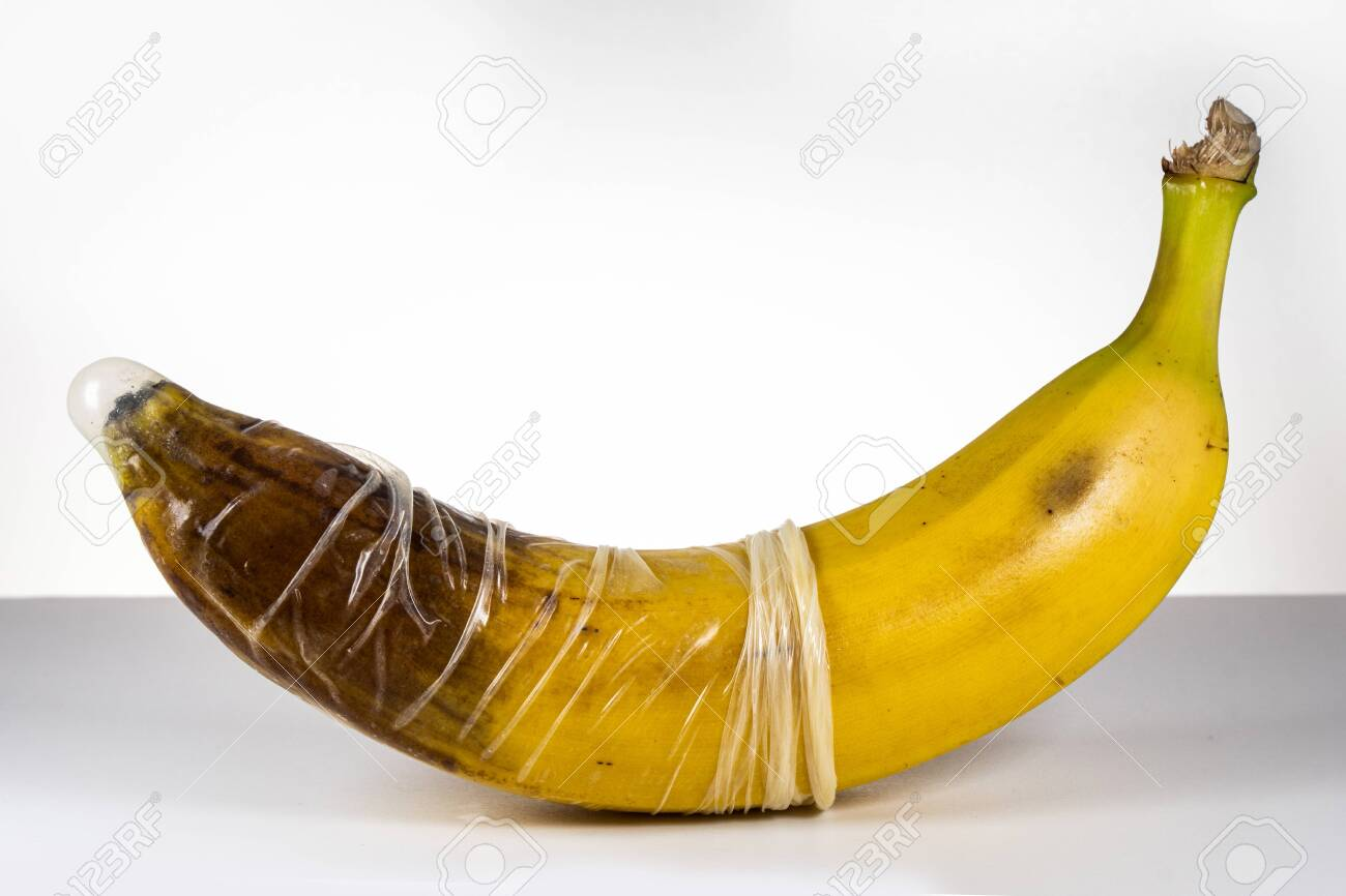 Condom over blackened banana. Concept for sexually transmitted infections, STD, STI - 149445880