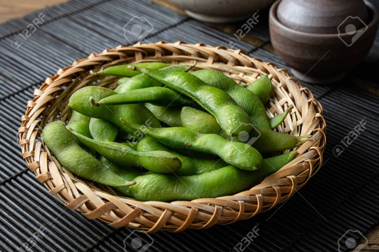 Edamame, a type of bean often eaten as an appetizer or snack in Japanese cuisine. - 149445894