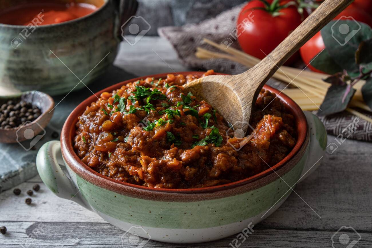 Bolognese tomato and beef sauce in rustic bowl. Traditional Italian sauce used for pasta. - 149445899