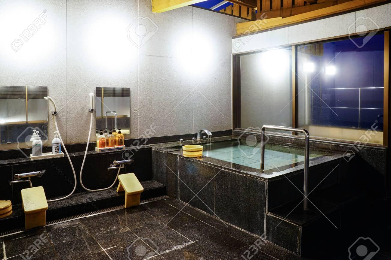 Indoor Japanese hot springs bath (onsen). - 149412044