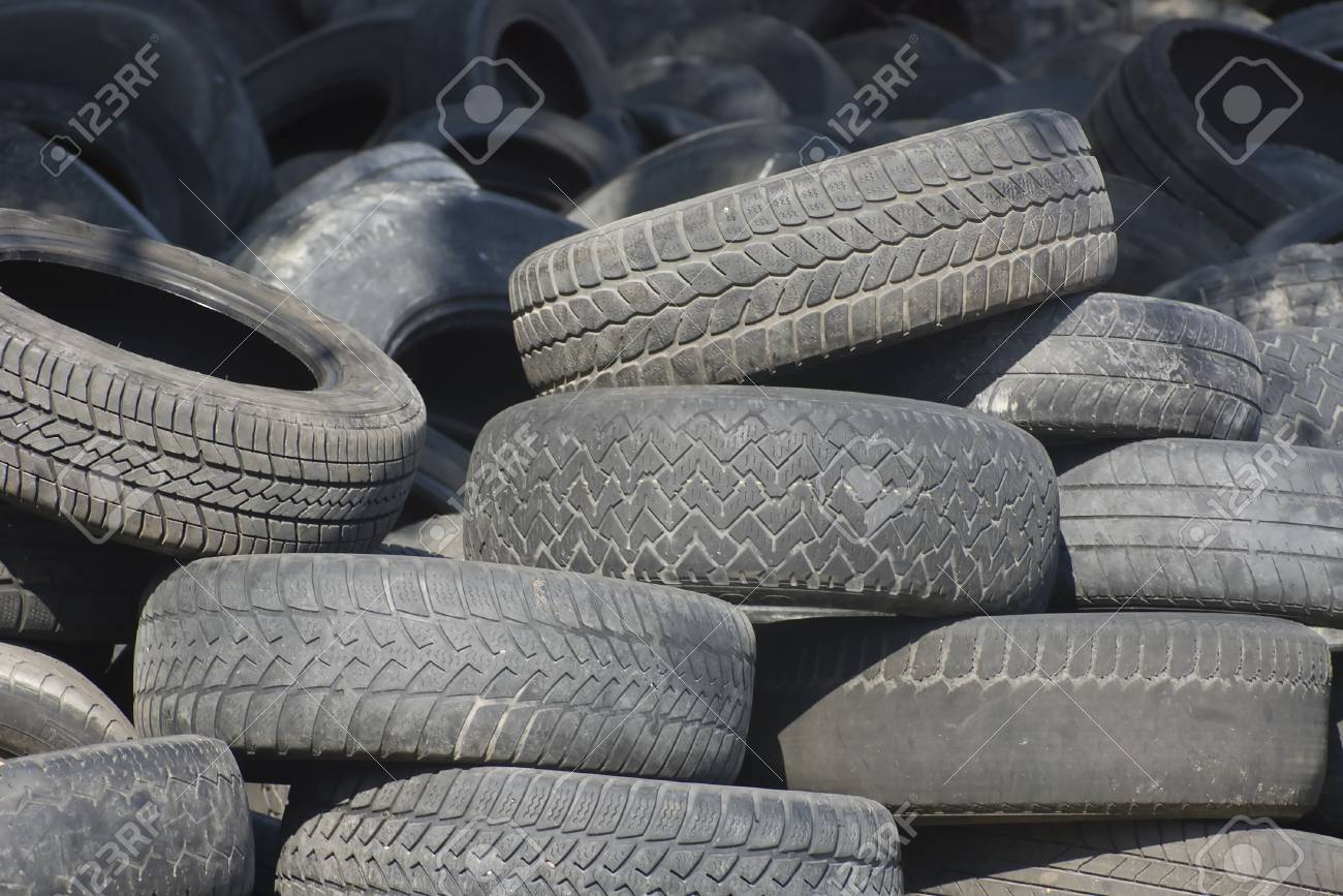 Pile of used old rubber tire Stock Photo - 24055132