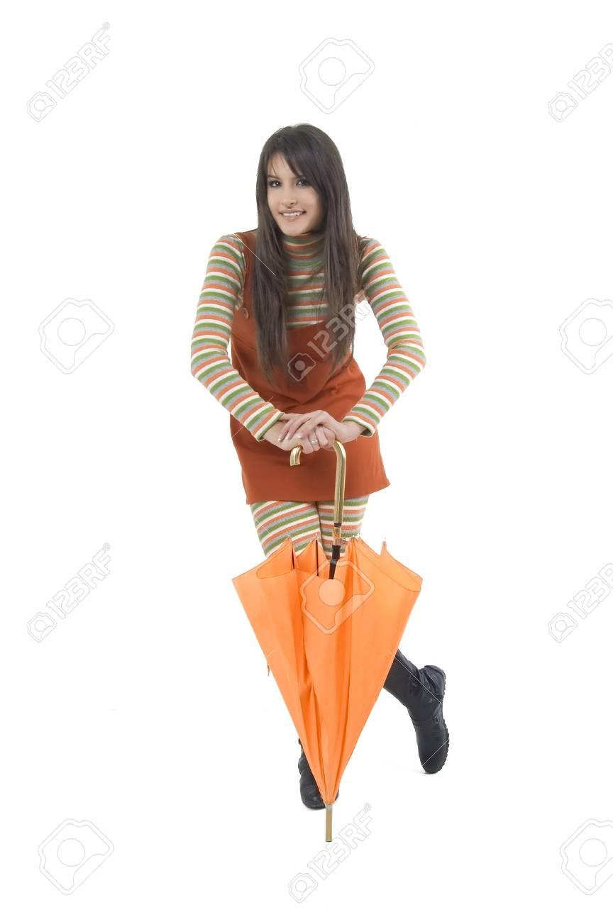 c7166a8cd75 Pretty girl with orange umbrella in her hand Stock Photo - 2576878