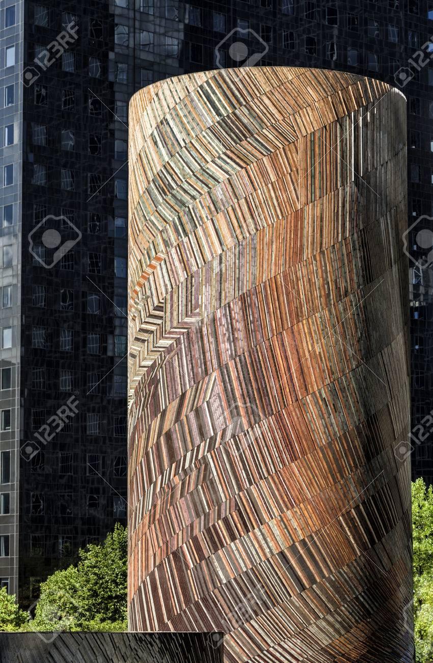 PARIS, FRANCE - August 20, 2016: La Defense, Vive Le Vent, The wind. Mosaic by Michel Deverne 1986. Cylinder mosaic in front of dark skyscraper - 65920600