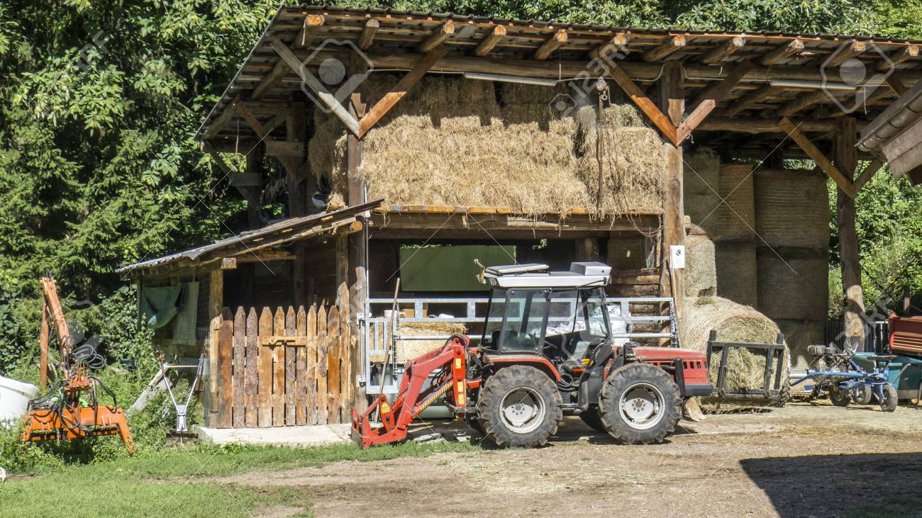 A tractor in front of the barn - 97235879