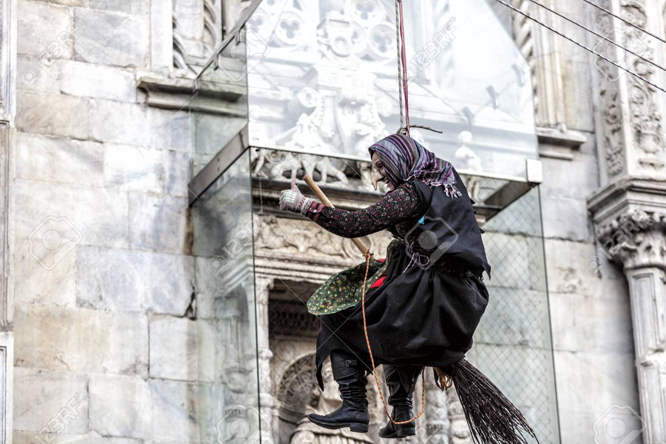 COMO, ITALY - January 6, 2017: during Epiphany an old woman flies bringing sweets to good children and coal to bad ones. Como Lake - 97261678