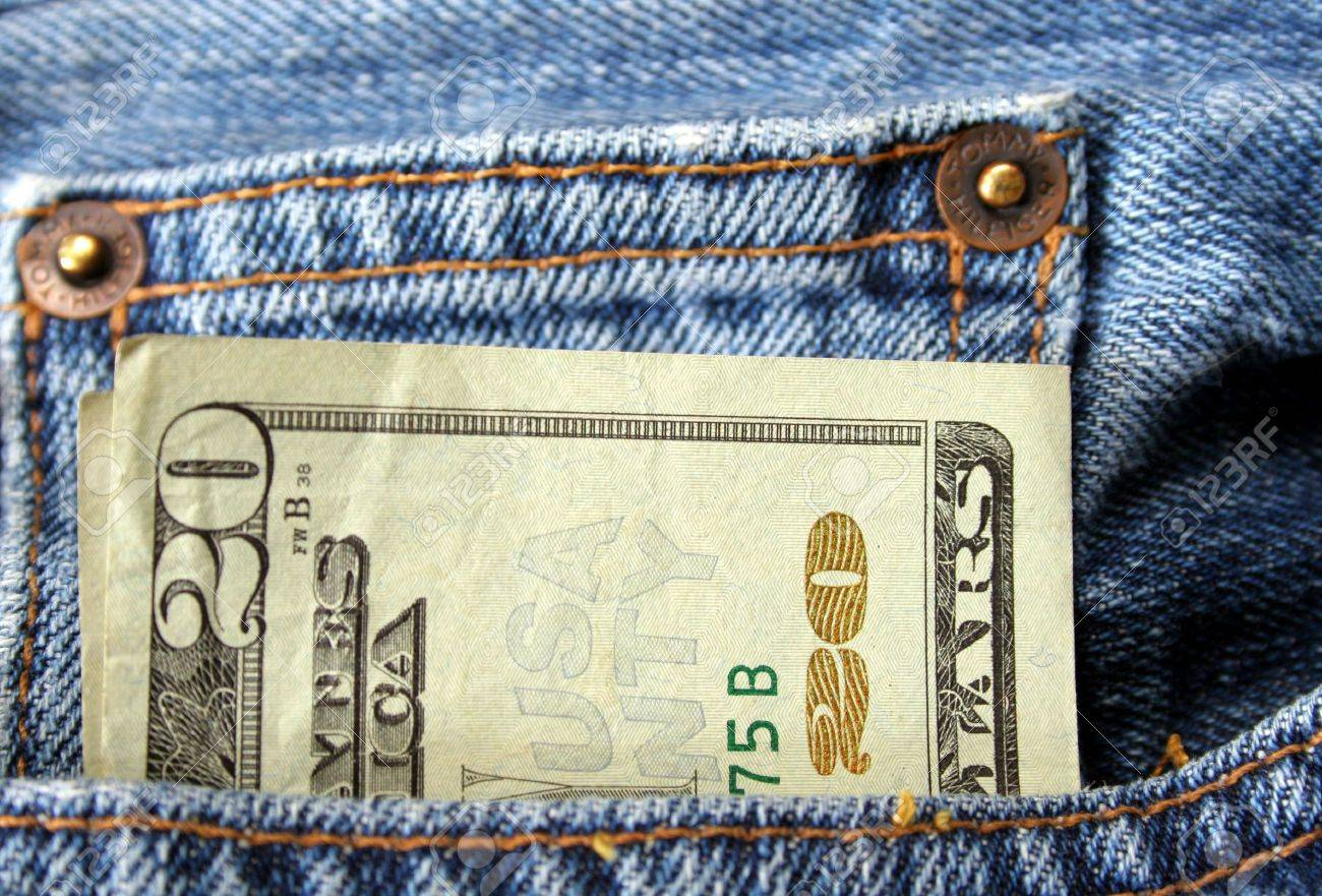 twenty dollar bill coming out of pocket of a pair of jeans Stock Photo - 2197421