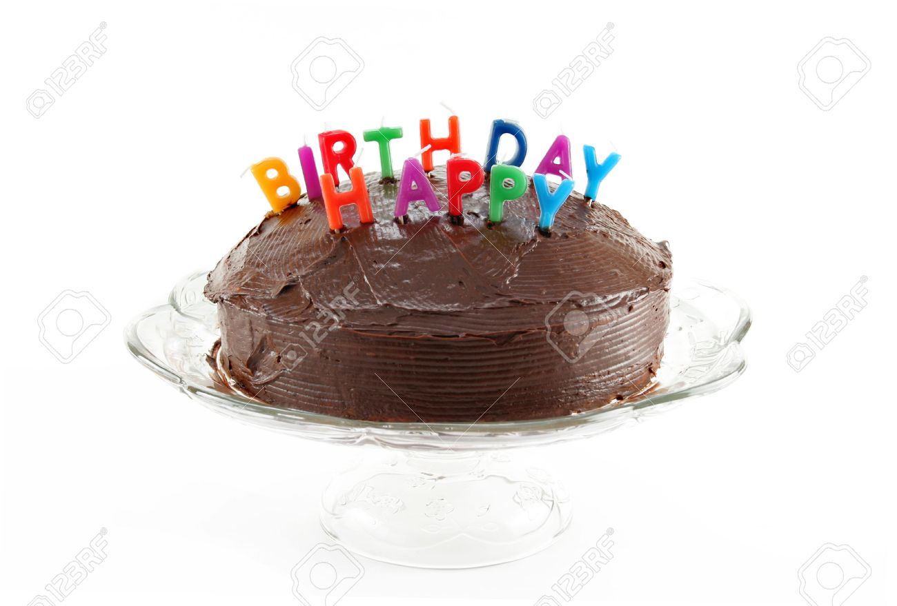 Chocolate Cake With Candles That Spell Out HAPPY BIRTHDAY On A Plate White