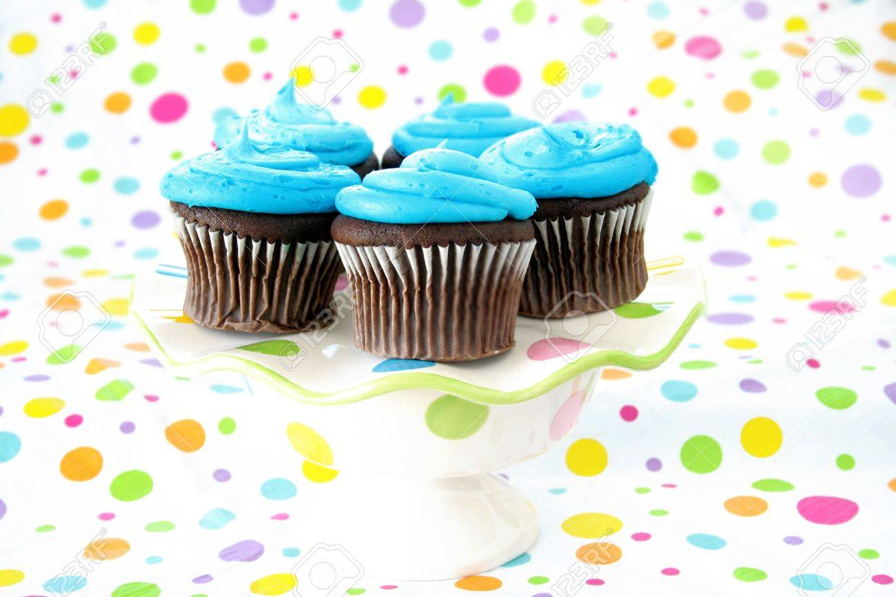 Cupcakes on a festive cake plate with a colorful background of colorful circles. Stock Photo - 4846082