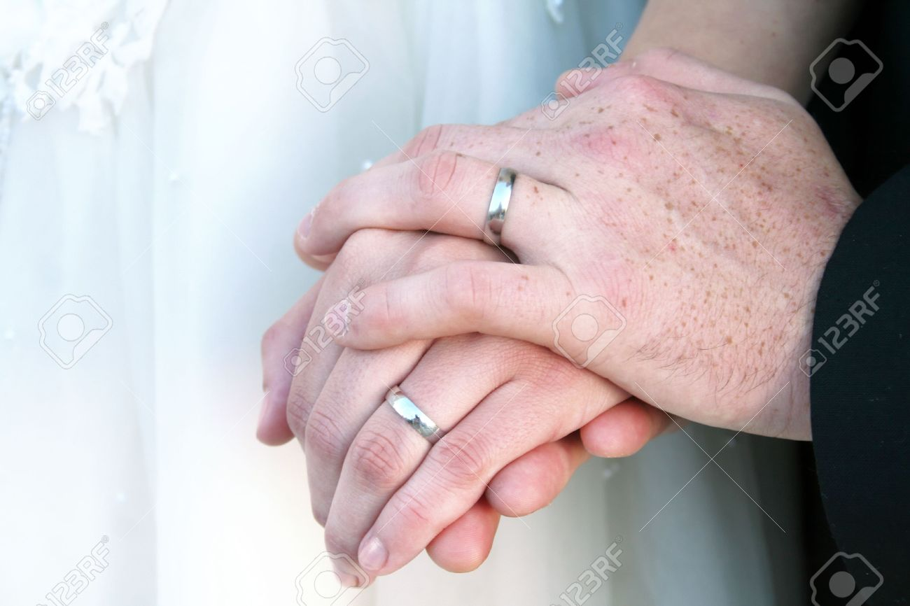 Newlywed Couples Hands With Wedding Rings. Stock Photo, Picture And ...