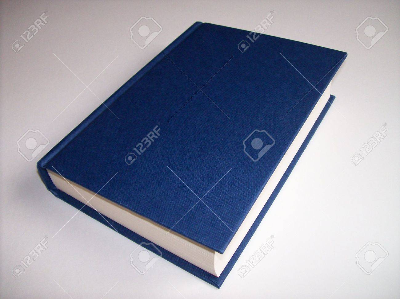 Close-up photo of a blue book on a white background Stock Photo - 7937223