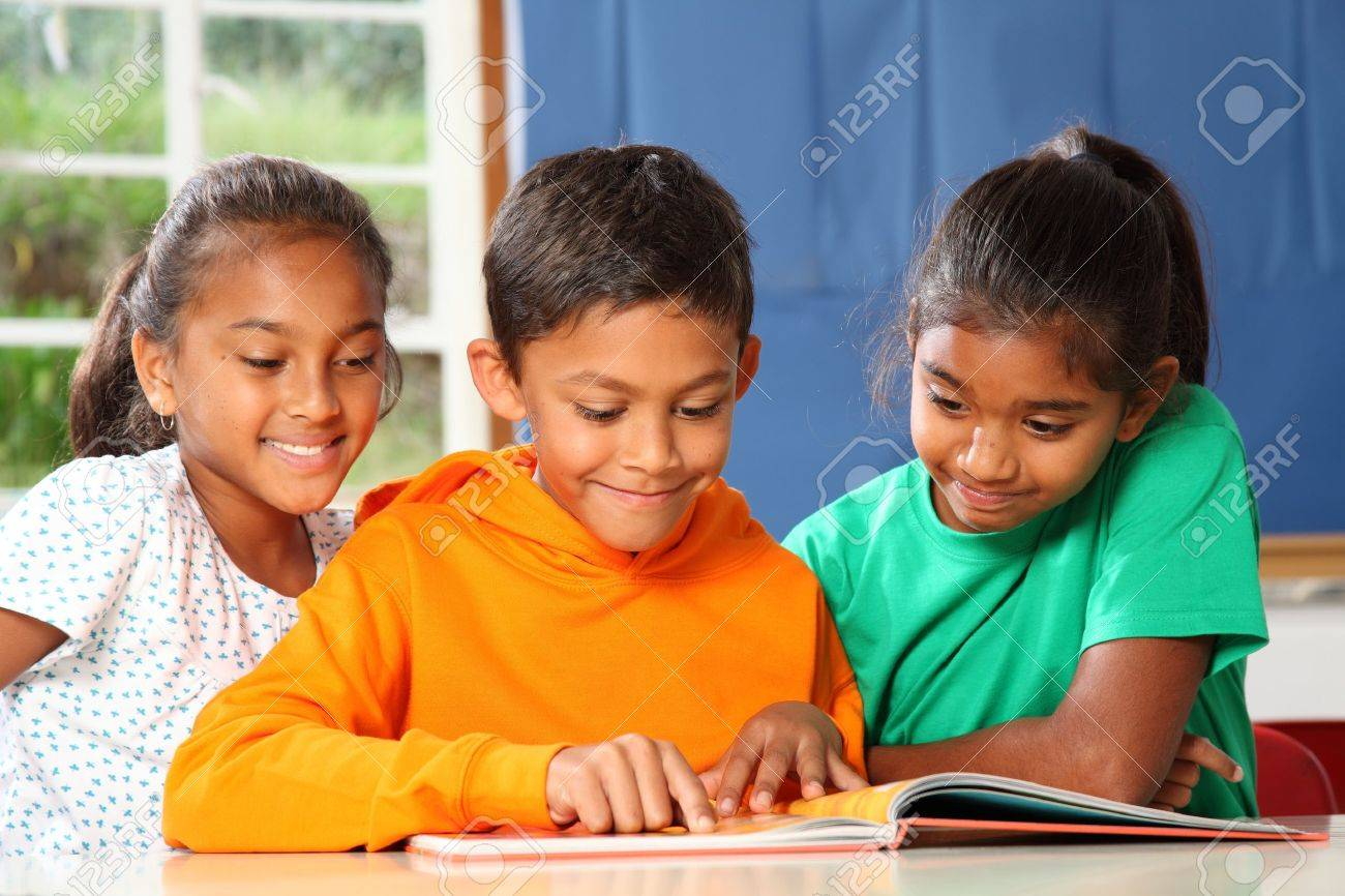 Primary school children in class reading learning Stock Photo - 9448343