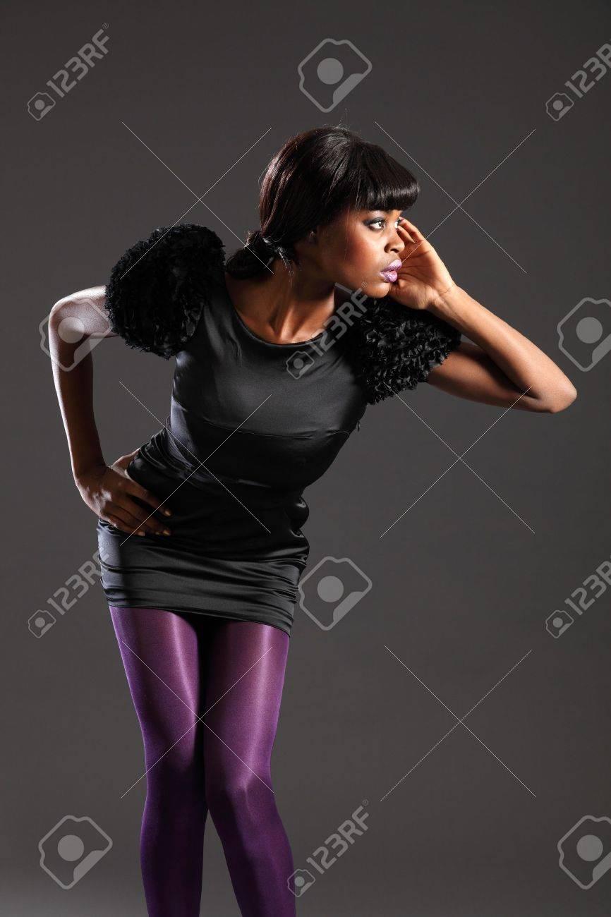 Sexy fashion model in purple tights black dress Stock Photo - 9534875