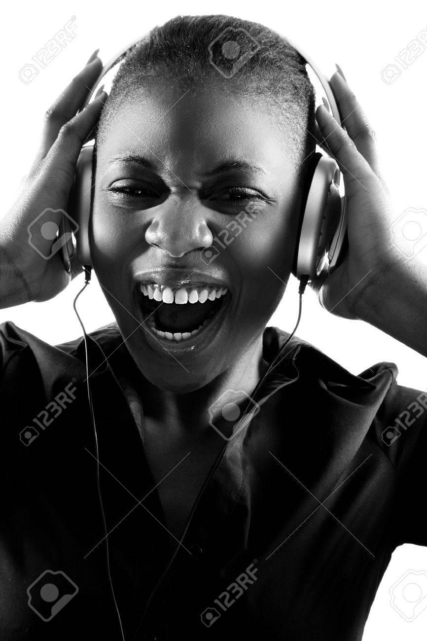 Black woman singing to music on headphones Stock Photo - 9534884