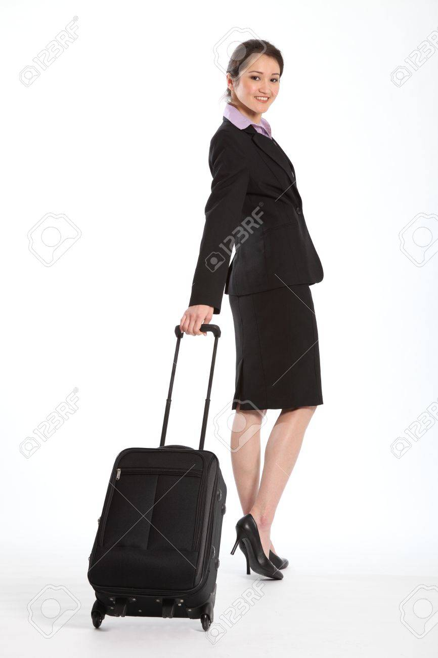 Business woman with carry on luggage Stock Photo - 9567640