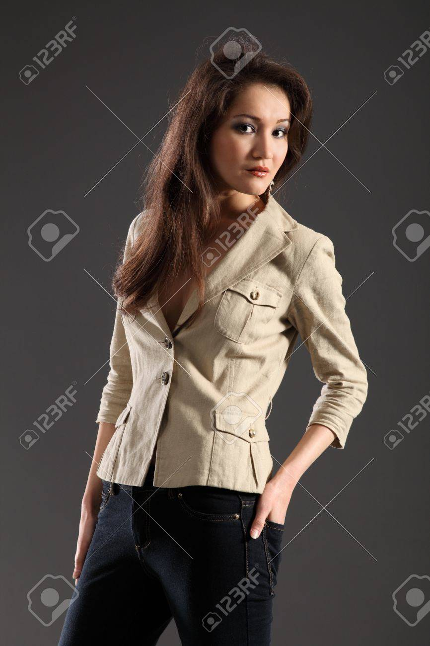 Long haired girl in skinny jeans and jacket Stock Photo - 9567971