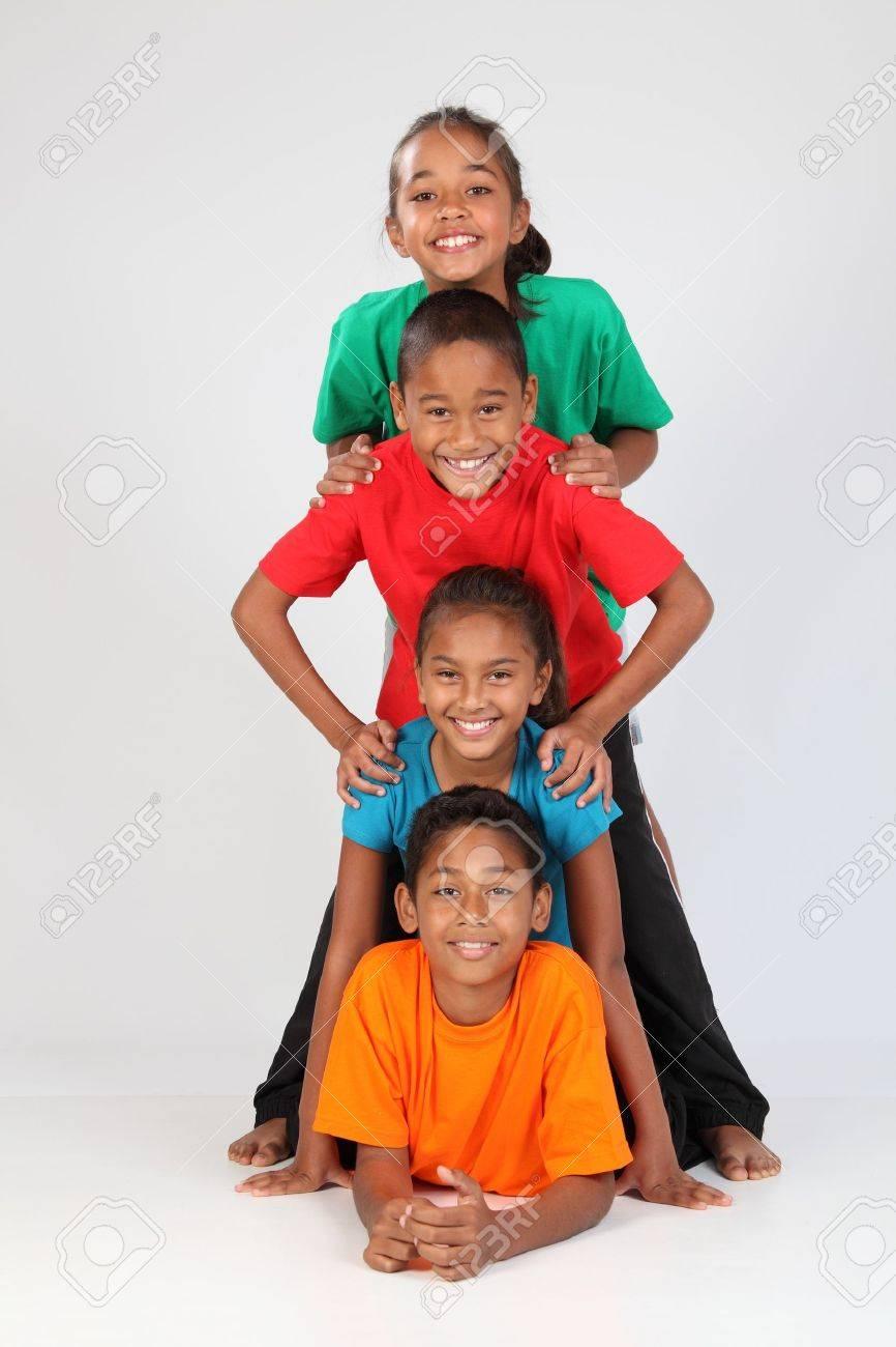 Cheerful school friends form human totem pole Stock Photo - 9568029