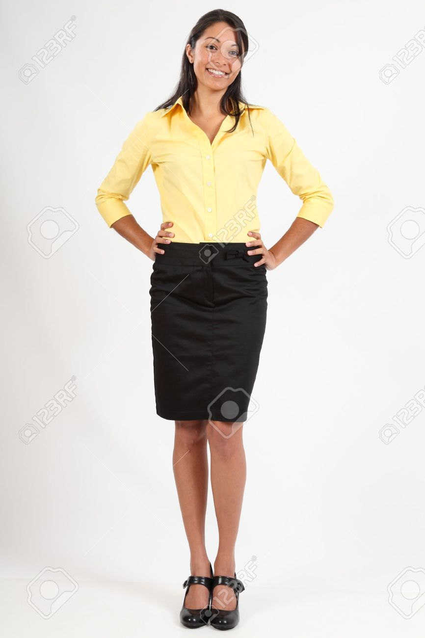 a1a85a4f0de8c2 Beautiful young woman in business blouse and skirt Stock Photo - 9568199