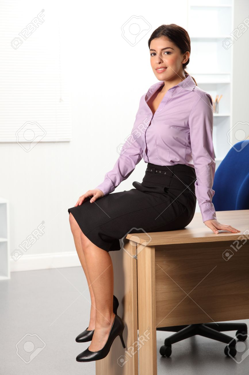 woman office furniture. Stock Photo - Young Business Woman Sitting On Office Desk Furniture O