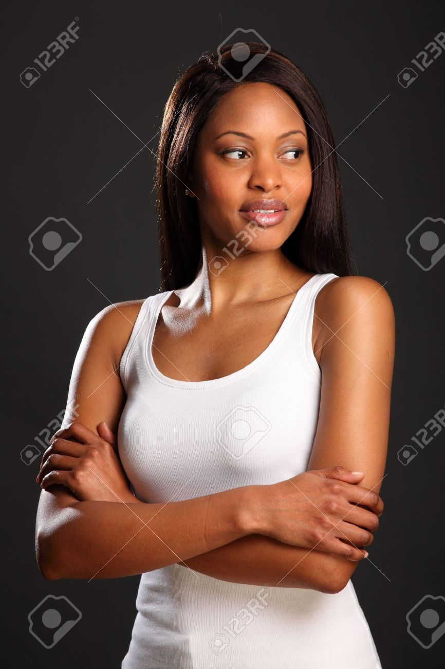 Beautiful black woman with arms folded in white vest Stock Photo - 9642549