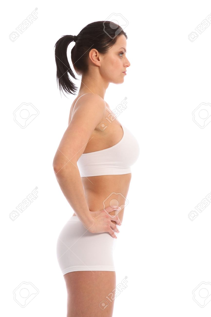 Profile view of beautiful healthy young woman wearing white sports underwear af7b7a1da
