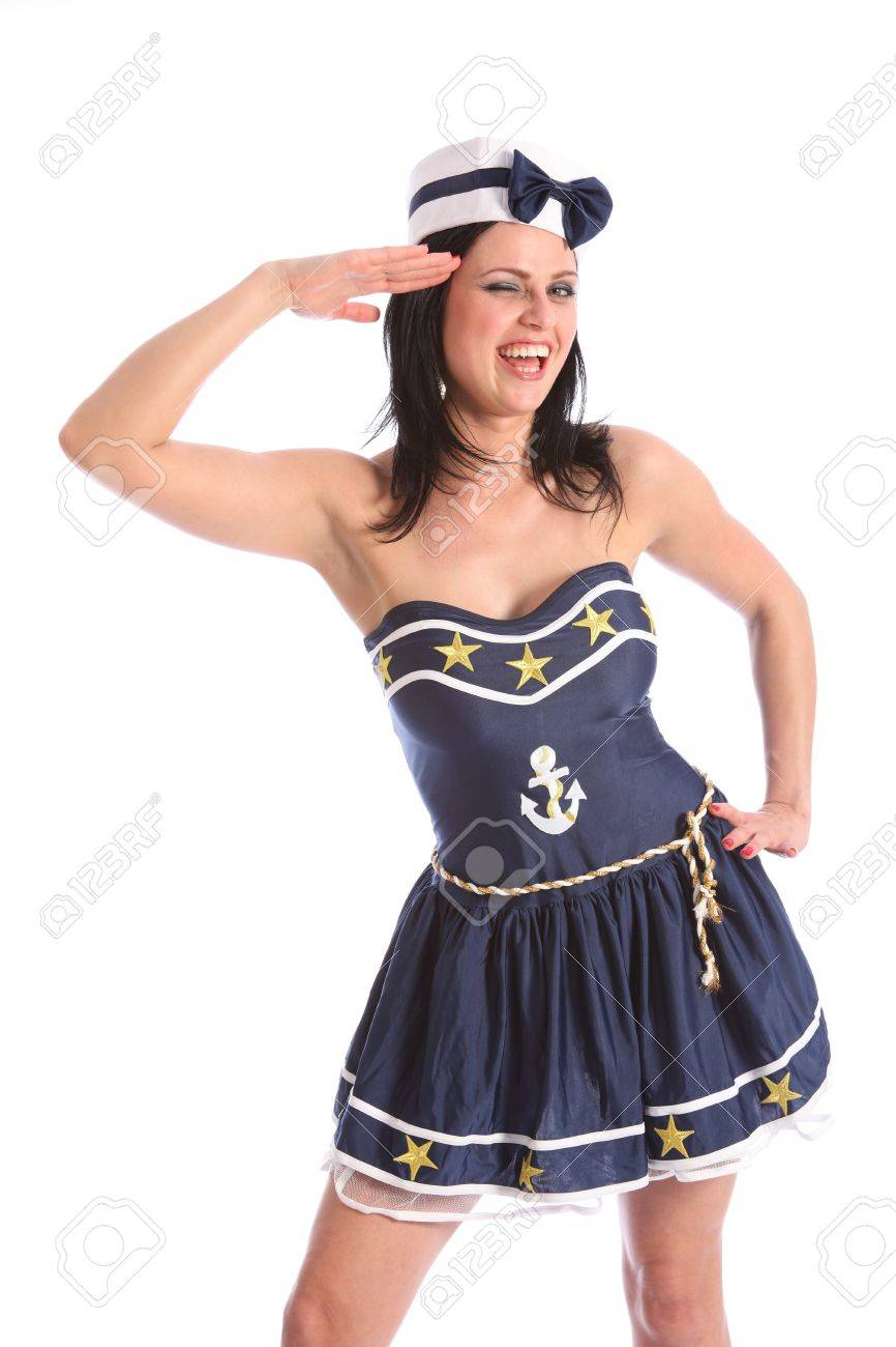 Fun salute by a beautiful young caucasian model wearing a sexy blue fancy dress sailor costume, with gold stars and hat. Model is laughing with big happy smile on her face. Stock Photo - 9746980
