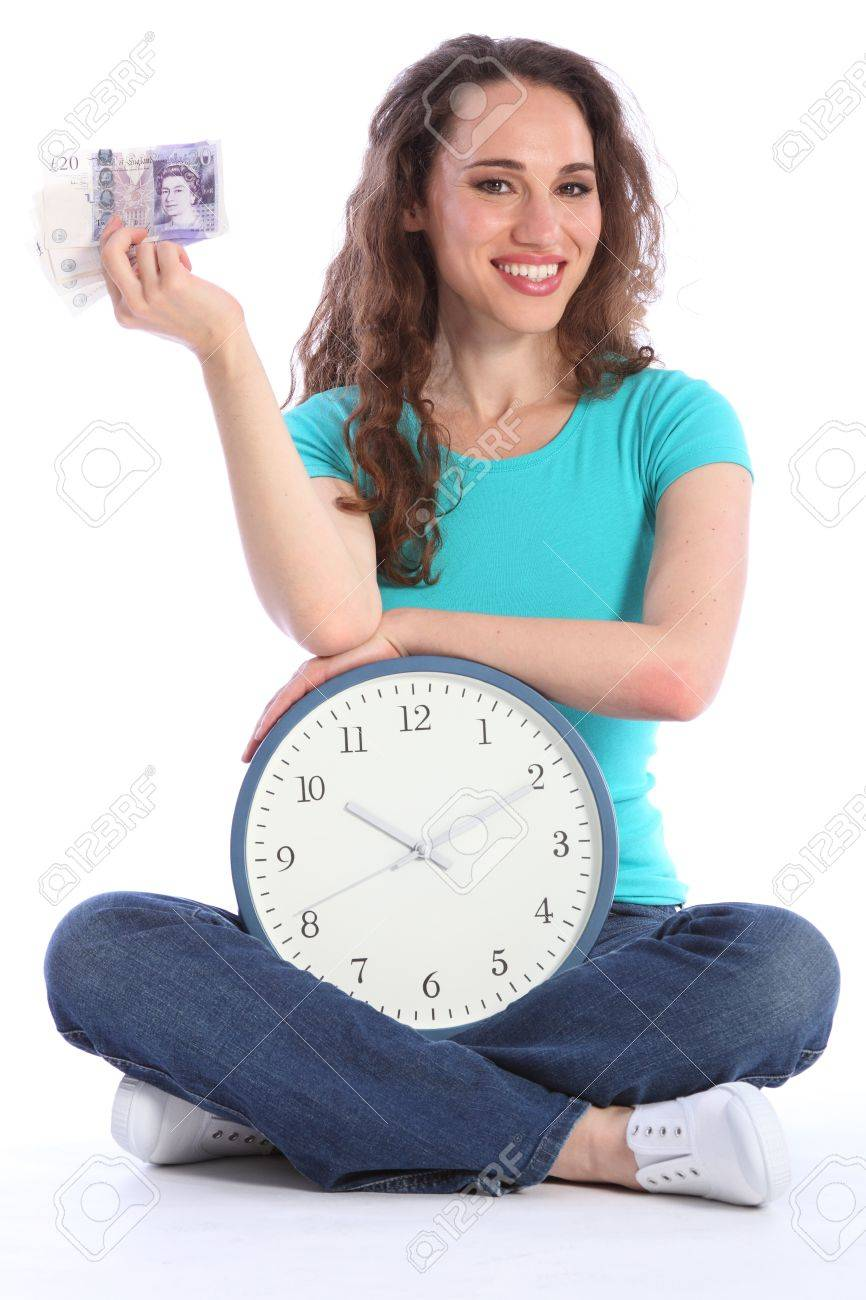 Time is money fun concept pose by beautiful sexy smiling girl sitting on  the floor with a large clock and cash in one hand. She has long brown hair  and is ...