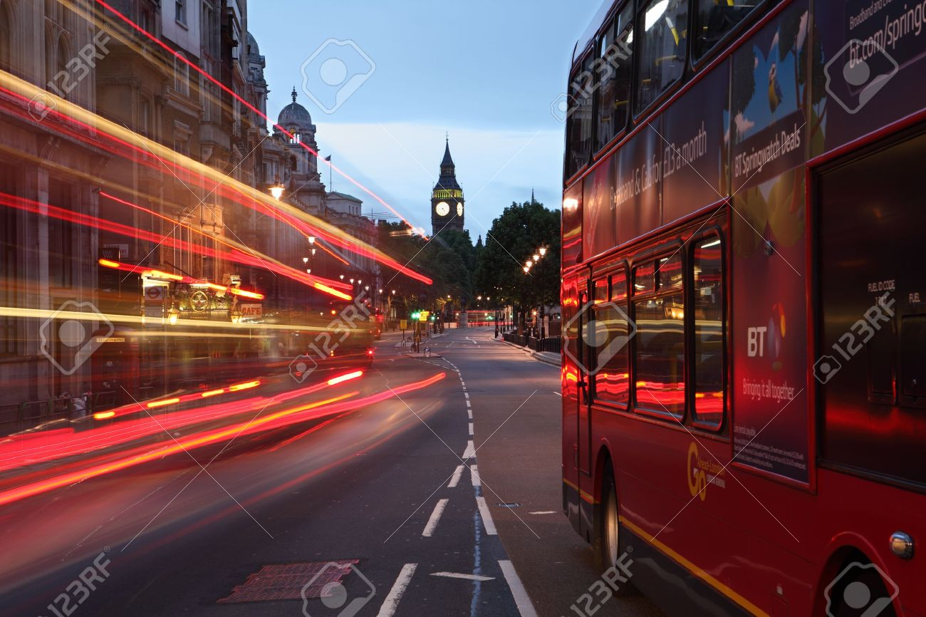 London england dawn breaking over the city of westminster, with the clock tower of Big Ben over the light trails of red london buses on the street. Stock Photo - 10034270