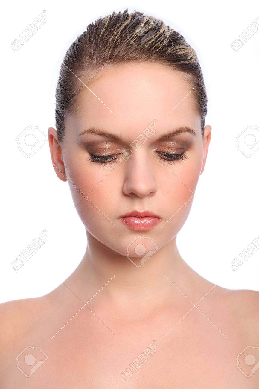 Headshot of beautiful young caucasian girl with eyes downward showing off natural make up for a cosmetics beauty look. Stock Photo - 10103138
