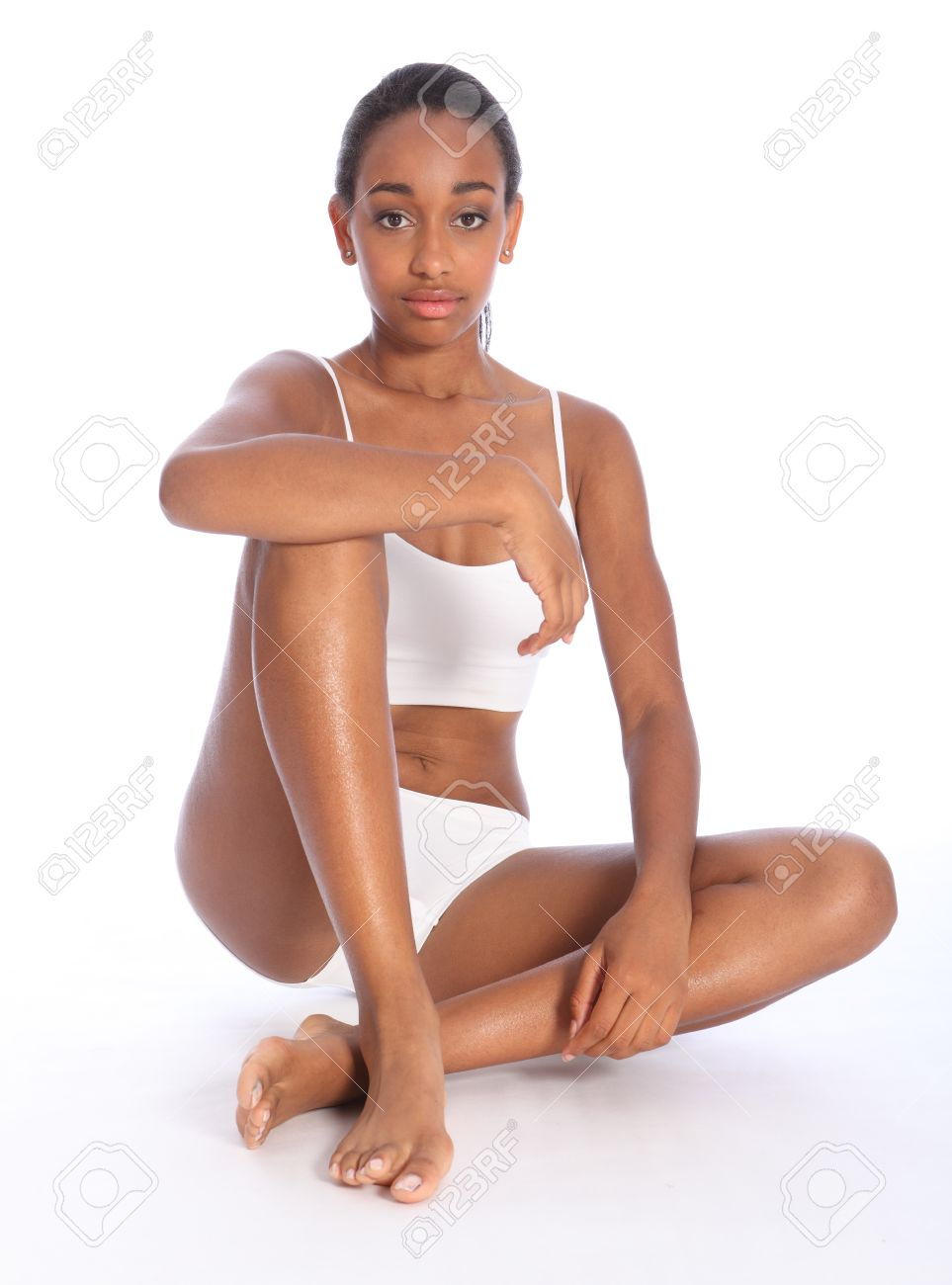 Healthy fit body of beautiful young black woman sitting on the floor 2e6a9d37f