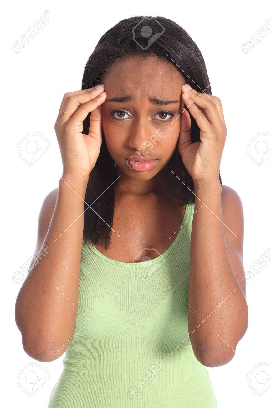 Painful headache for young african american girl, holding her hands to temples with hurt showing on her face. Shot against white background. Stock Photo - 10429861