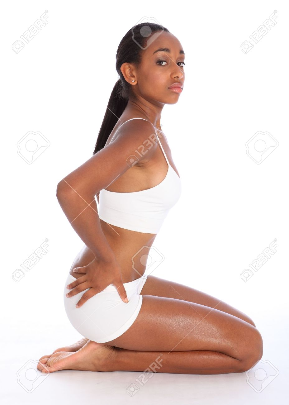 Profile view of a beautiful healthy young african american woman wearing  white sports underwear showing off ebf67ae6d