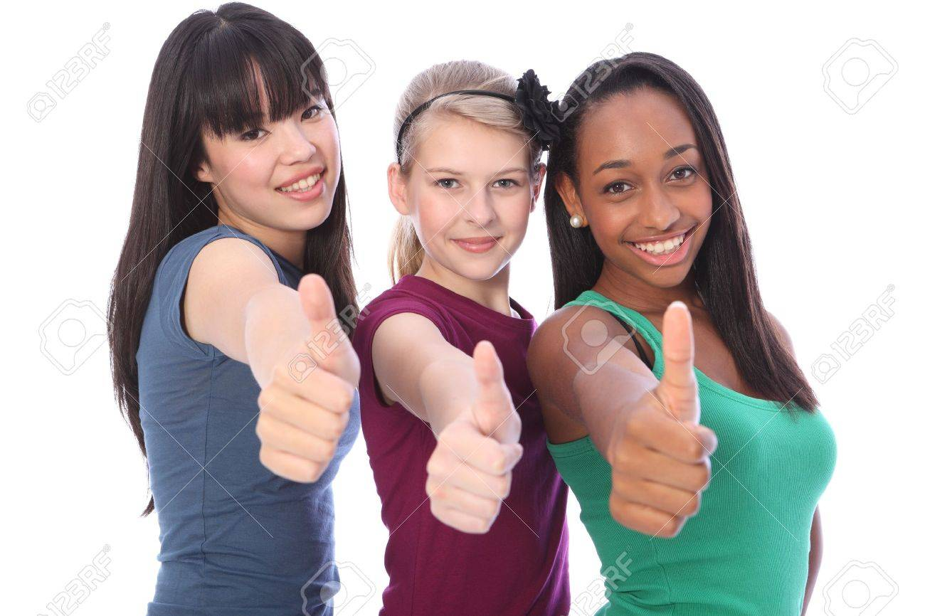 Thumbs up for success by three multi cultural teenage school student friends made up of mixed race african american, oriental Japanese and caucasian all happy holding hands out to camera. Stock Photo - 10782742