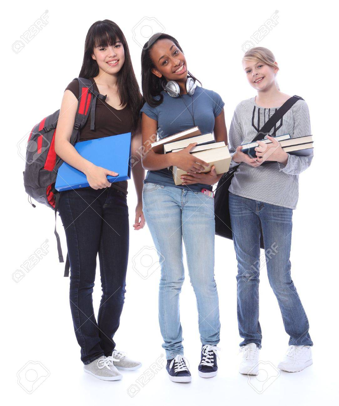 Education time for three multi ethnic teenage student girl friends made up of mixed race african american, oriental Japanese and caucasian with school books. Stock Photo - 10782714