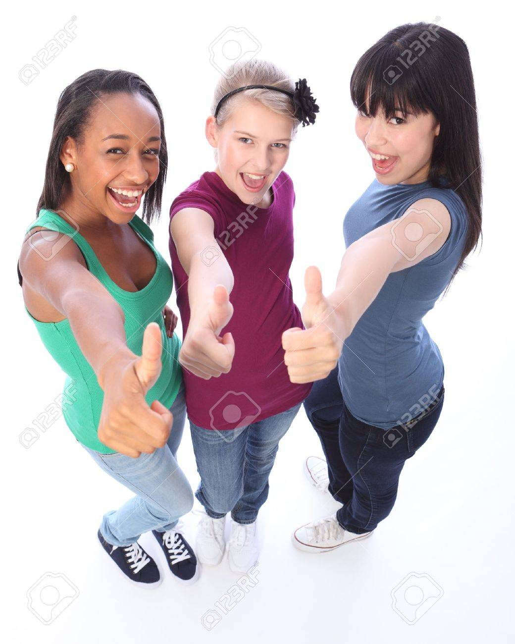 Excited thumbs up in success by three multi cultural teenage school student friends made up of mixed race african american, oriental Japanese and caucasian all happy holding hands out to camera. Stock Photo - 10782760