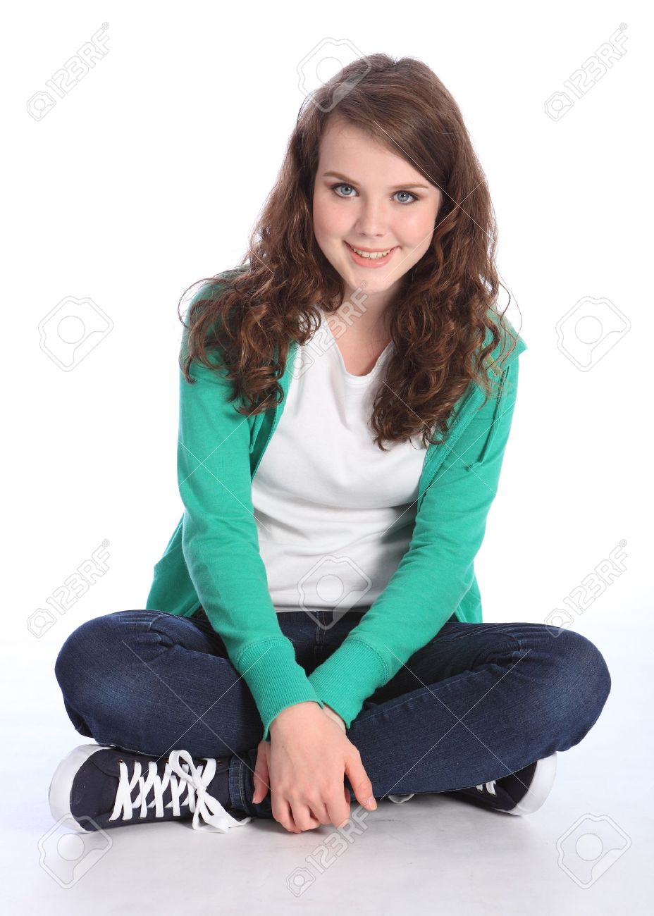 Sitting Cross Legged On Floor A Beautiful High School Teenager Girl With  Long Brown Hair Wearing