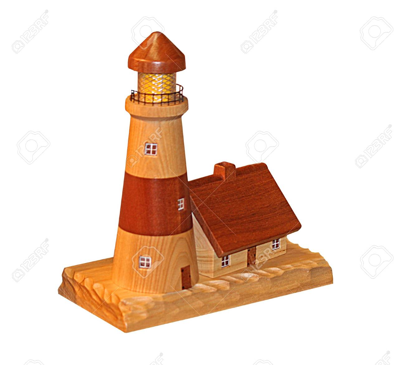 A Wooden Model Of Lighthouse And Cottage Stock Photo
