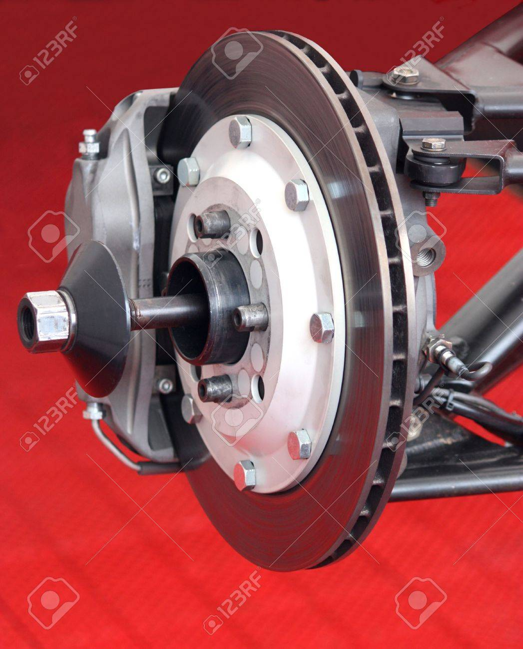 the front brake disc assembly of a racing car stock photo