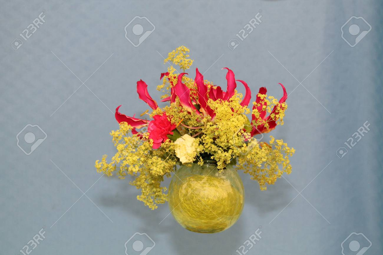 A red and yellow flower arrangement in a glass dome stock photo a red and yellow flower arrangement in a glass dome stock photo 48097090 mightylinksfo