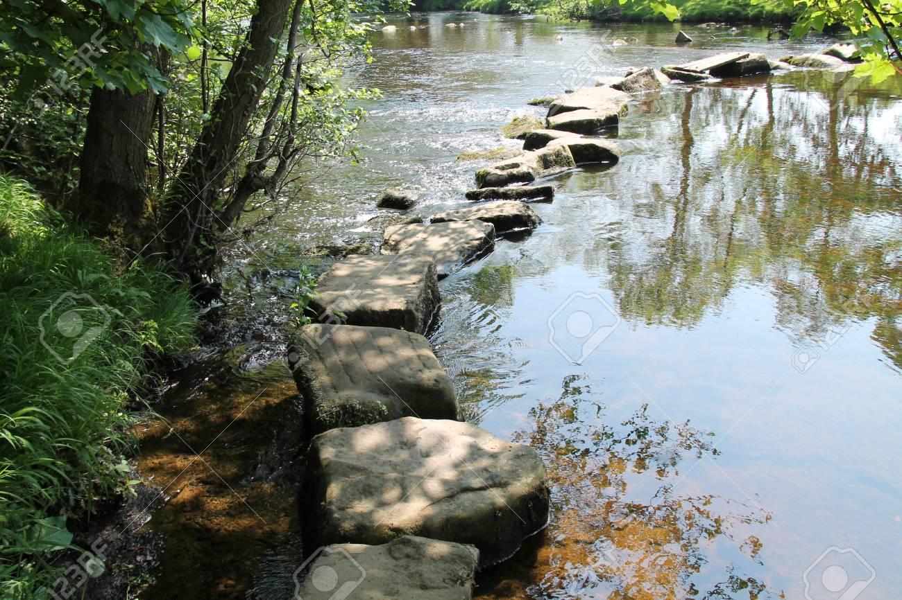 Rocky Stepping Stones Across a Beautiful Rural River. - 60709238