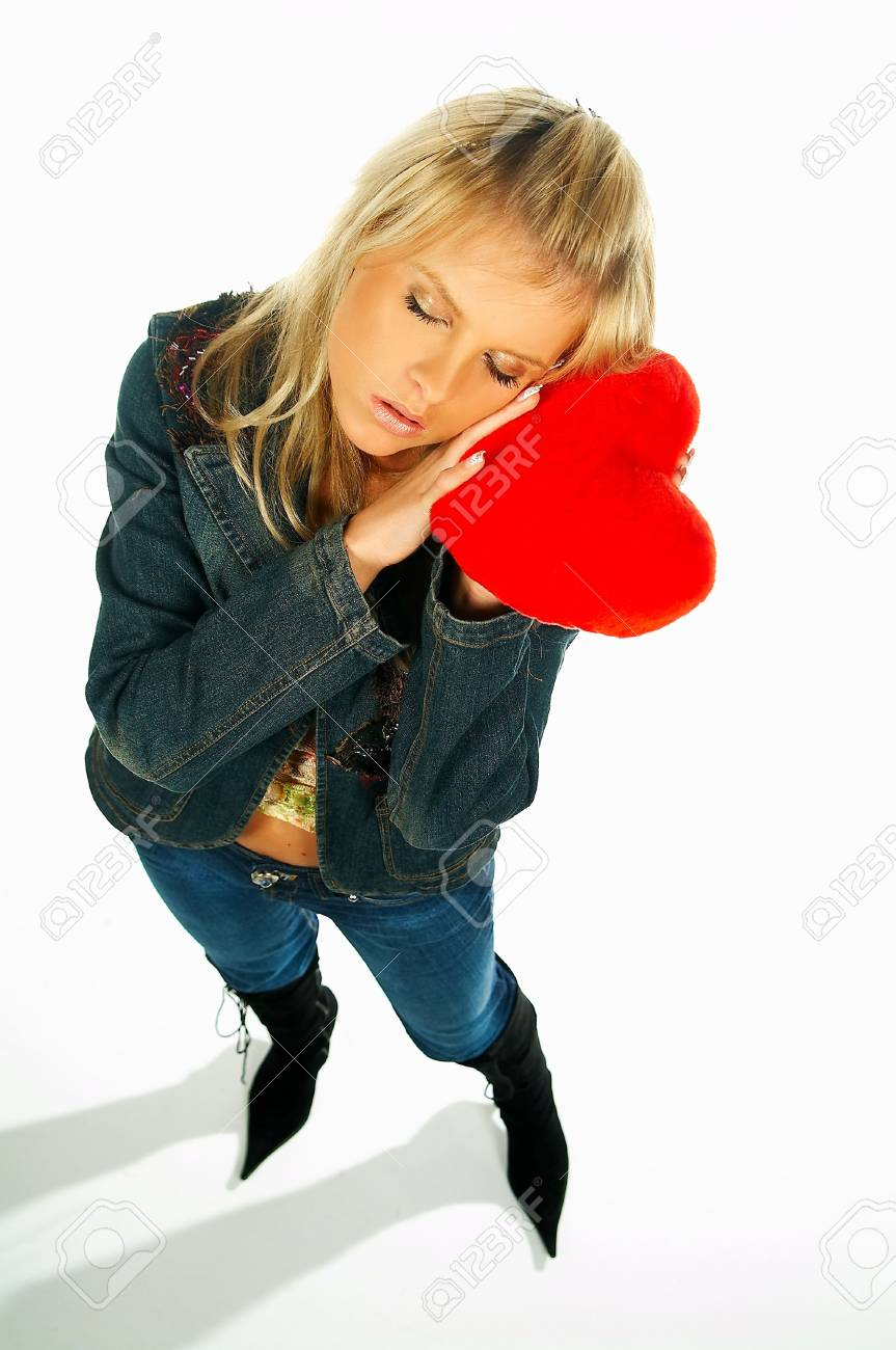 Blonde sexy girl holding a red velvet heart Stock Photo - 341519