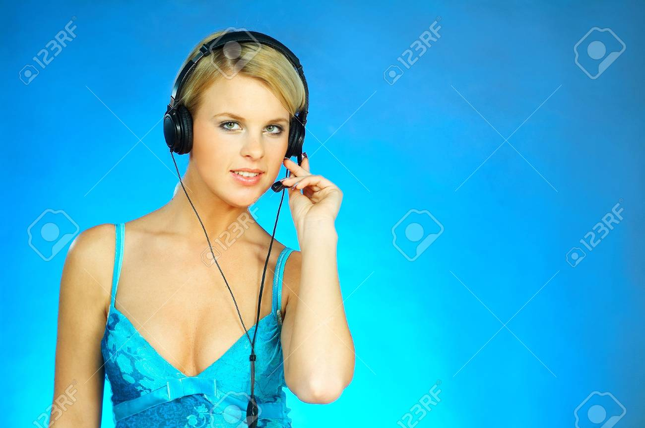 Young pretty woman wearing a phone headset. Call Centre Agent Stock Photo - 350000