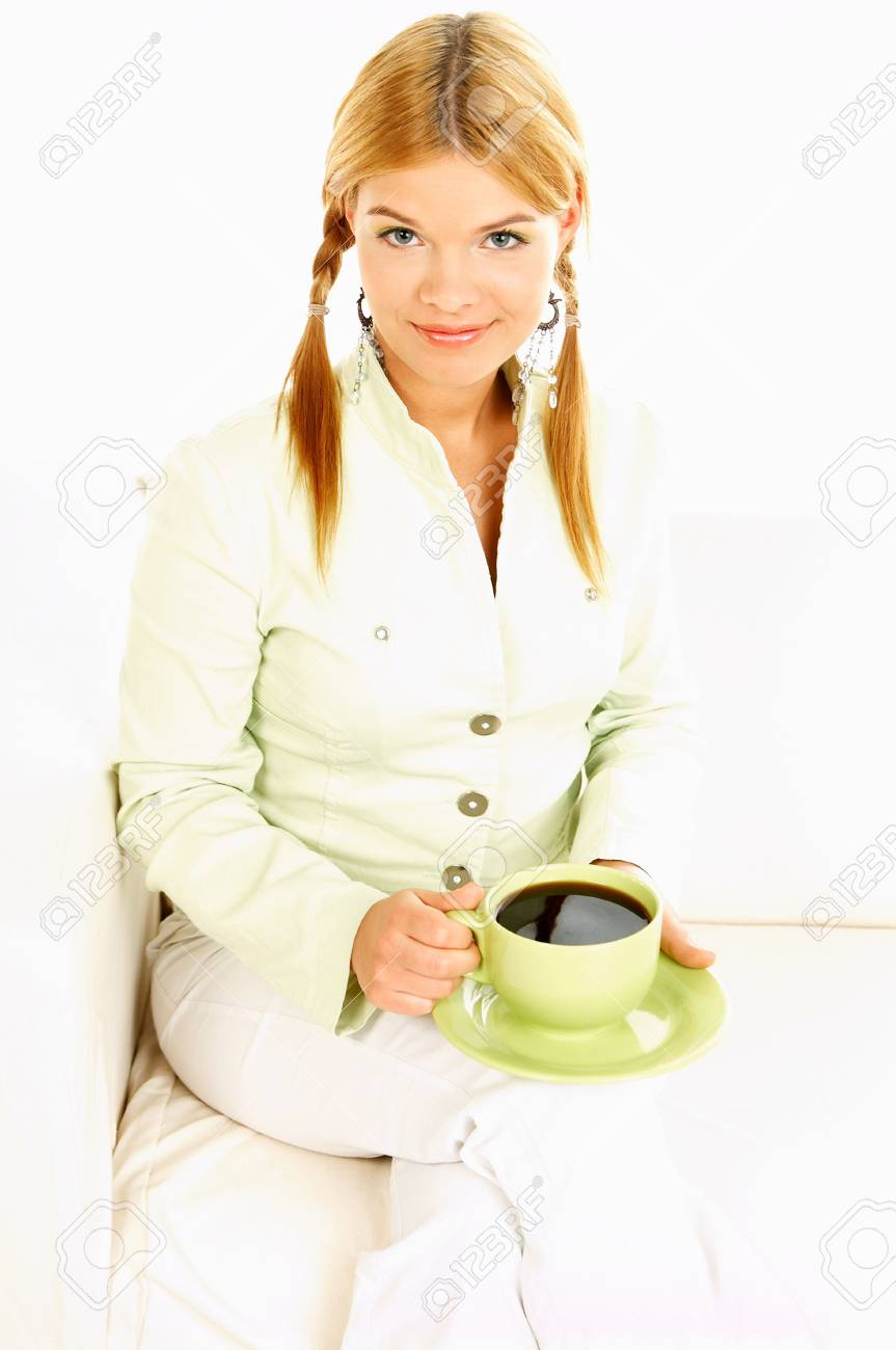 Portrait of attractive beautiful young woman with green cup od black coffee Stock Photo - 411429