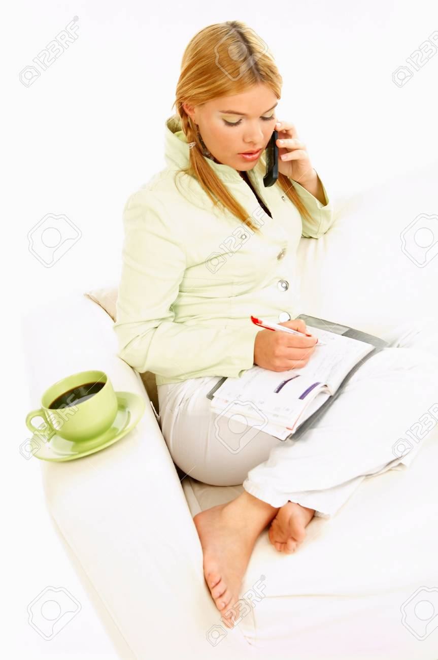Portrait of attractive beautiful young woman with green cup of black coffee cell phone and notebook Stock Photo - 411423