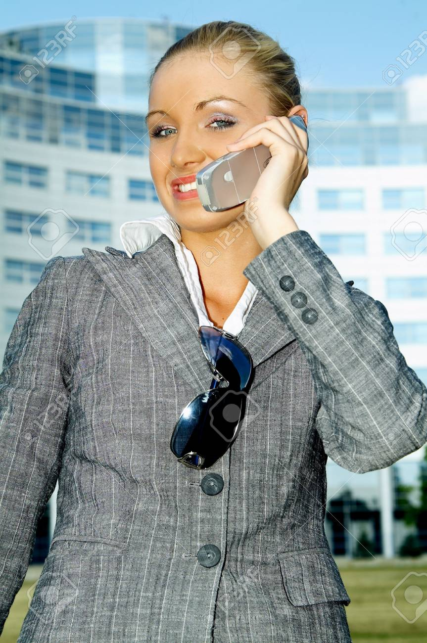 Business woman using a mobile phone Stock Photo - 453901